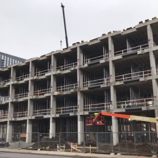 Conversion of an existing 4 story office building to a 5 story 91 room Holiday Inn